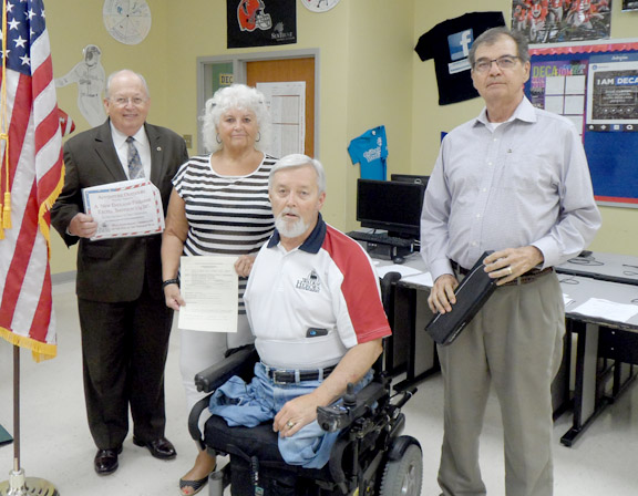 Raffle Winners for The Moving Wall exhibit held at the walk of heroes.  Left to Right, James Waters, Patricia Hill, Tommy Clack, Harry Wuest.